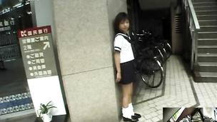 Barely legal Asian in school uniform sucking inside a restroom