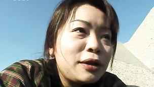 Horny Japanese uses vibrator at the sea shore